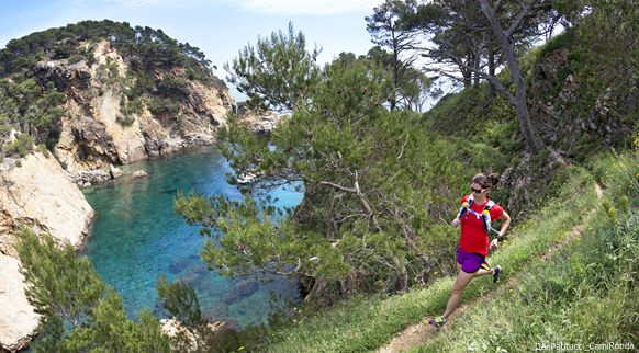 Woman trail running by the Mediterranean